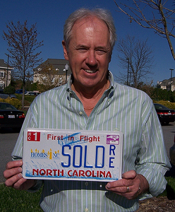 Bruce Williams with his Homes4NC License Plate