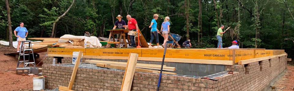 Volunteers building foundation of home for Habitat for Humanity on REALTORS Give Back Day